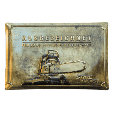 Embossed tin metal sign for Stihl, 60 cm x 40 cm in three metallic versions; this is gold