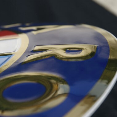 Alfa Romeo porcelain enamel sign, detailed view of the embossing featuring real gold