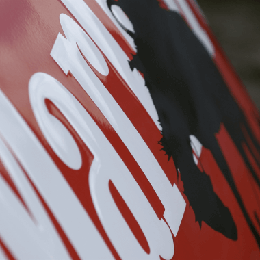 View of a detail of the Marlboro porcelain enamel sign, lightly embossed writing