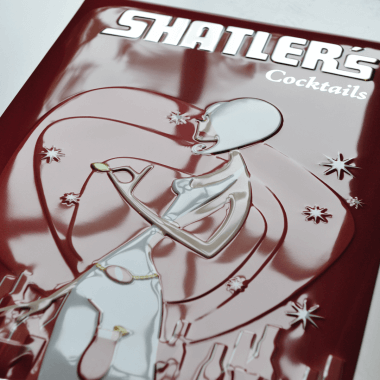 Shatlers tin metal sign, detailed view of the embossing