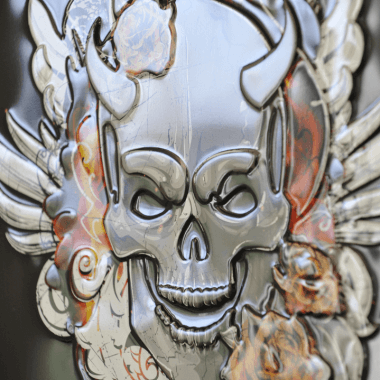 Advertising sign tin metal Trojka Devil, detailed view of the embossing
