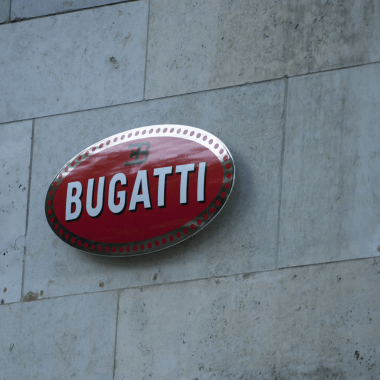 Bugatti porcelain enamel sign; here you can see how the sign essentially floats in the air thanks to the hidden mechanism that holds it in place